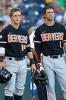 Oregon State second baseman Andy Peterson (14) and Oregon State shortstop Tyler Smith (1) before Game 9 of the 2013 Men's College World Series against the Indiana Hoosiers on June 19, 2013 at TD Ameritrade Park in Omaha, Nebraska. The Beavers defeated the Hoosiers 1-0, eliminating Indiana from the tournament. (Andrew Woolley/Four Seam Images)