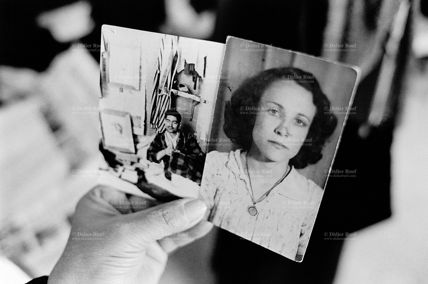 Iraq. Baghdad. Iraqi women league. Fadila Alewi holds in her hand a couple of old pictures from 1960 of her husband and herself. Her husband killed in 1963 by the Baath party (previous to the Saddam Hussein regime), because he was a communist. 20.02.04 © 2004 Didier Ruef .