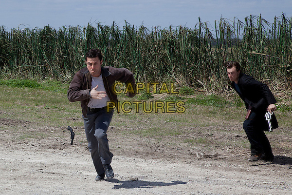 Joseph Gordon-Levitt & Noah Segan.in Looper (2012) .*Filmstill - Editorial Use Only*.CAP/FB.Supplied by Capital Pictures.