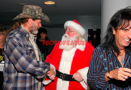 Ted Nugent and Santa Claus at Alice Cooper's Christmas Pudding show for his Solid Rock Foundation Charity at Dodge Theatre in Phoenix, Arizona, December 18th 2004. Photo by Chris Walter/Photofeatures.