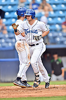 Asheville Tourists left fielder Casey Golden (11) rounds the bases after hitting a home run during a game against the Augusta GreenJackets at McCormick Field on August 19, 2018 in Asheville, North Carolina. The Tourists defeated the GreenJackets 6-3. (Tony Farlow/Four Seam Images)