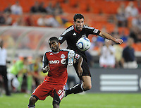 DC United midfielder Chris Pontius (13) goes against Toronto FC defender Ashtone Morgan (5) DC United tied Toronto FC 3-3 at RFK Stadium, Saturday August 6 , 2011.