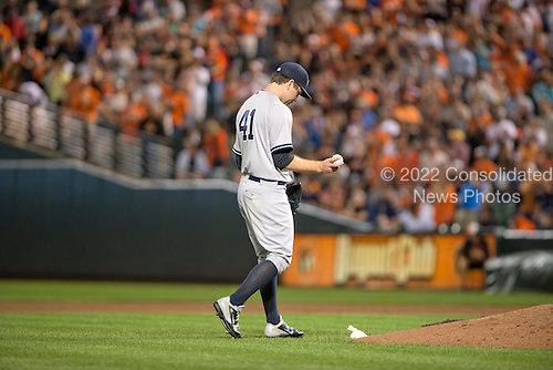 New York Yankees pitcher David Phelps (41) walks dejectedly back to the mound after allowing a two run single to the Baltimore Orioles designated hitter Delmon Young in the seventh inning at Oriole Park at Camden Yards in Baltimore, MD on Friday, September 12, 2014.  Phelps  was replaced. The Orioles won the game 5 - 0.<br /> Credit: Ron Sachs / CNP<br /> (RESTRICTION: NO New York or New Jersey Newspapers or newspapers within a 75 mile radius of New York City)