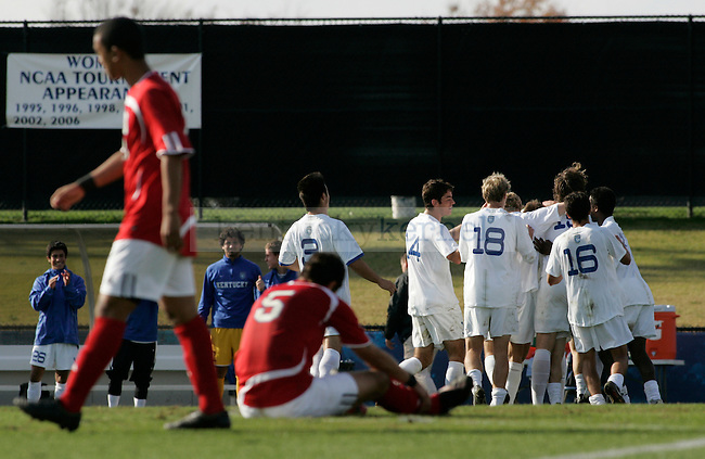 The UK men's soccer team celebrates after senior forward Tim Crone scored a goal against SMU during their game at Softball and Soccer Complex on Wednesday, Nov. 4, 2009. Photo by Allie Garza | Staff