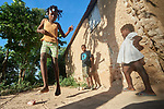 As her siblings look on, 10-year old Rosemie Love plays hopscotch in Picmy, a village on the Haitian island of La Gonave where Service Chrétien d'Haïti is working with survivors of Hurricane Matthew, which struck the region in 2016. SCH, a member of the ACT Alliance, supports home reconstruction, road repair, and the revitalization of the rural economy.