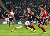 24th November 2019; Bramall Lane, Sheffield, Yorkshire, England; English Premier League Football, Sheffield United versus Manchester United; Mason Greenwood of Manchester United scores in the 77th minute to make it 2-2 with Chris Basham and Phil Jagielka  of Sheffield United close by - Strictly Editorial Use Only. No use with unauthorized audio, video, data, fixture lists, club/league logos or 'live' services. Online in-match use limited to 120 images, no video emulation. No use in betting, games or single club/league/player publications