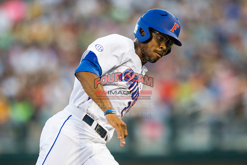 Florida Gators outfielder Buddy Reed (23) rounds third base headed home against the Miami Hurricanes in the NCAA College World Series on June 13, 2015 at TD Ameritrade Park in Omaha, Nebraska. Florida defeated Miami 15-3. (Andrew Woolley/Four Seam Images)