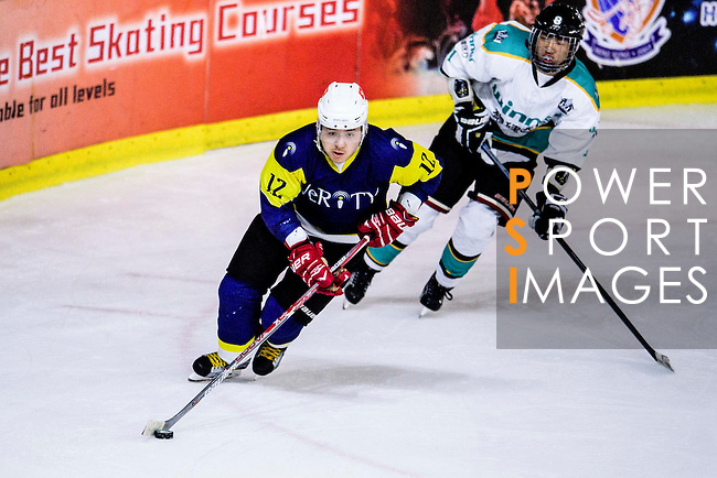 Verity Skater #12 Leo Kan (l) in action during the Principal Standard League match between Medical Winner Kings vs Verity at the Mega Ice on 17 January 2017 in Hong Kong, China. Photo by Marcio Rodrigo Machado / Power Sport Images
