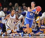 SIOUX FALLS, SD - MARCH 5:  Rachel Rinehart #31 of Fort Wayne looks to pass as Alexis Alexander #1 of South Dakota State looks on in the 2016 Summit League Tournament. (Photo by Dick Carlson/Inertia)
