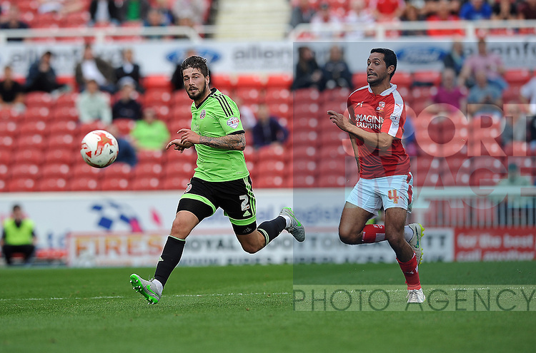 Kieron Freeman of Sheffield United is challenged by Fabien Robert of Swindon Town<br /> - English League One - Swindon Town vs Sheffield Utd - County Ground Stadium - Swindon - England - 29th August 2015