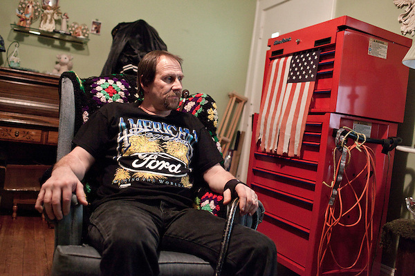 March 29, 2010. Winston Salem, North Carolina.. After 14 years of using Poligrip denture cream to keep his teeth in place, Johnny Howell became disabled due to nerve damage from high zinc levels that may have been caused by the cream. His nerve damage is so severe that Mr. Howell had to quit his job as a mechanic and must now use a cane or walker to get around his house, which he rarely leaves, and only with assistance.. Mr. Howell sits in the front room of his house next to his mechanic's tool box which he wants to sell but has been unable to do so.