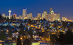 Seattle, Washington<br /> Night view of the city skyline and hillside homes of the Magnolia neighborhood