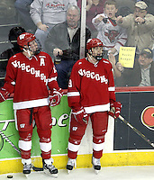 Wisconsin's Jake Gardiner (left) watches as fans taunt Mark Zengerle after Zengerle was whistled for tripping with two seconds remaining in the first period. No. 16 UNO beat No. 7 Wisconsin 4-3 Saturday night at Qwest Center Omaha. (Photo by Michelle Bishop)