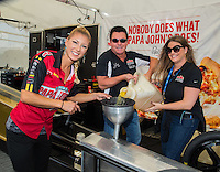 Oct 15, 2016; Ennis, TX, USA; NHRA top fuel driver Leah Pritchett and Papa Johns Pizza owner John Schnatter during qualifying for the Fall Nationals at Texas Motorplex. Mandatory Credit: Mark J. Rebilas-USA TODAY Sports