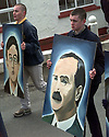 A Sinn Fein supporters (from left) carries a paintings of 1916 republicans David Plunket and James Connelly though the village of Carrickmore, County Tyrone, Northern Ireland, Sunday April 12, 1998, during a commemoration march for the anniversary of the 1916 Easter uprising. Hundreds of Republicans mark the anniversary by a series of marches all over Northern Ireland (AP Photo/Paul McErlane)