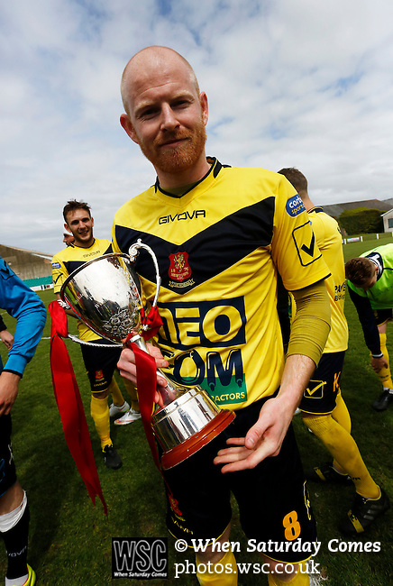 Aberystwyth Town 1 Newtown 2, 17/05/2015. Park Avenue, Europa League Play Off final. Newtown's Matthew Cook celebrates with the Play Off winners trophy. Aberystwyth finished 14 points above Newtown in the Welsh Premier League, but were beaten 1-2 in the Play Off Final. Photo by Paul Thompson.