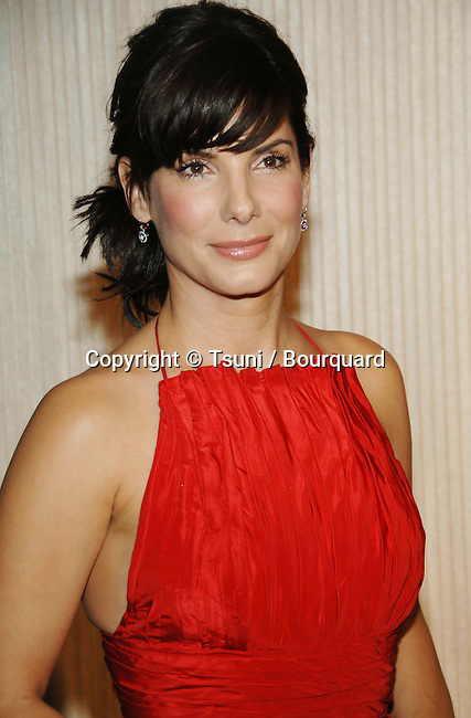 Sandra Bullock arriving at the 10th Annual Hollywood Film Festival - HFF - At the Beverly Hilton in Los Angeles.<br /> <br /> headshot<br /> red dress