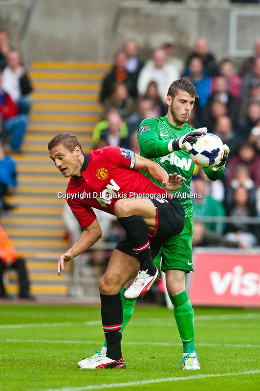 Saturday 17 August 2013<br /> <br /> Pictured: Nemanja Vidic (captain) of Manchester United and David de Gea of Manchester United<br /> <br /> Re: Barclays Premier League Swansea City v Manchester United at the Liberty Stadium, Swansea, Wales