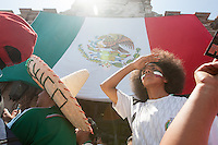 Los Angeles, CA -  Monday, June 23, 2014: Hundreds of Mexico fans watch the Mexico vs. Croatia first round match at a public viewing at Plaza Mexico.