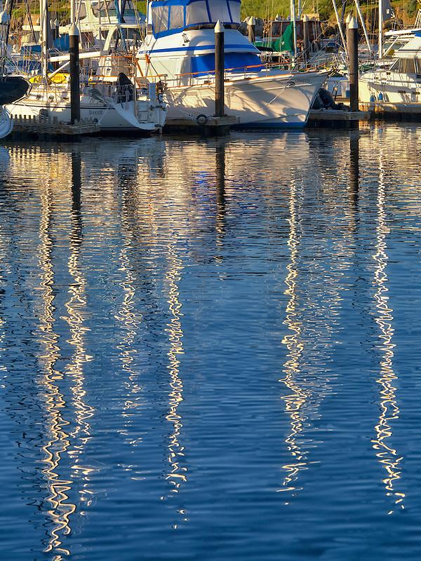 Reflected sailing masts and boats at Monterey Harbor and Marina, California