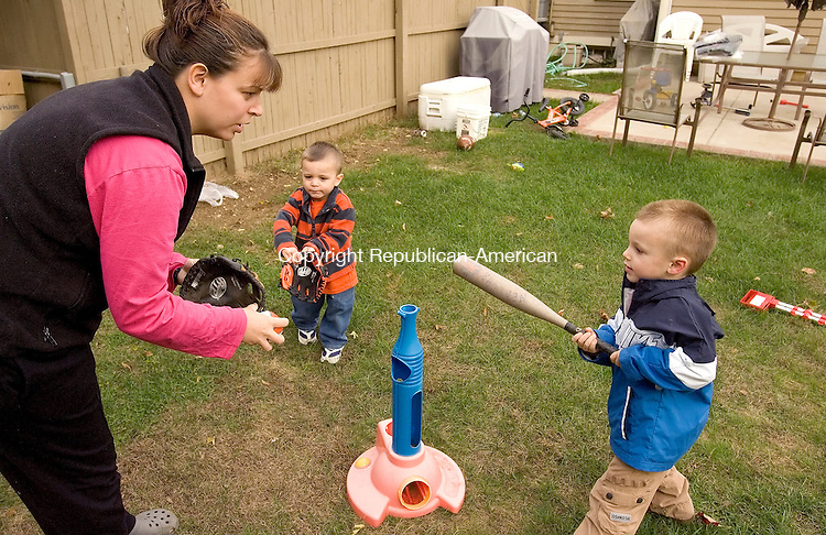 NAUGATUCK, CT-- 02 NOVEMBER 2007--110207JS17-As part of a healthy lifestyle Jennifer Stone plays with her two boys  Justin Stone, 4, right and Blake Stone, 2, center in the backyard of their Naugatuck home. <br /> Jim Shannon / Republican-American