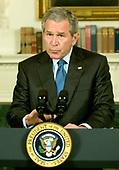 United States President George W. Bush makes a statement defending the National Security Agency's (NSA) collecting phone information in the Diplomatic Reception Room at the White House in Washington, D.C. on May 11, 2006.<br /> Credit: Ron Sachs / Pool via CNP