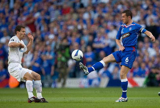 Barry Ferguson hooks the ball away from Konstantin Zyrianov