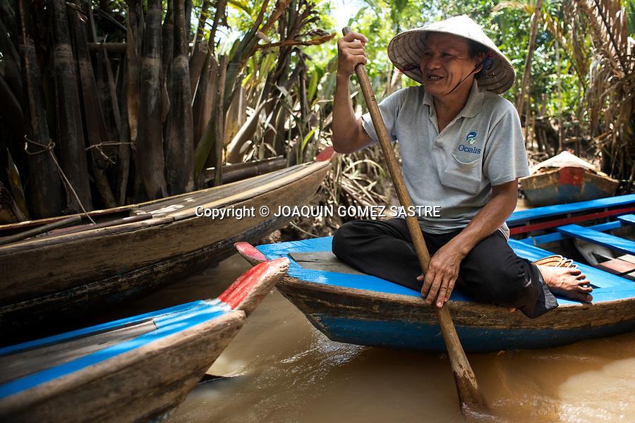 Portrait of a ferryman in the Mekong River Delta in Ho Chi Minh (Vietnam)<br /> HO CHI MINH-VIETNAM