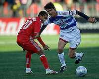 11 April 2009:  FC Dallas midfielder Pablo Ricchetti #6 attempts to take the ball up field past Toronto FC midfielder Amado Guevara #20 during an MLS game at BMO Field in Toronto between FC Dallas and Toronto FC. The game ended in a 1-1 draw.