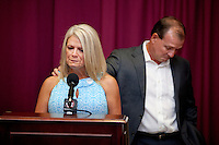 TALLAHASSEE, FLA. 8/4/11-FISHER080511 CH-Florida State University Head Football Coach Jimbo Fisher, right, comforts wife Candi as she talks about Fanconi anemia, a rare blood disorder their six-year-old son Ethan was diagnosed with earlier this year, Friday during a news conference in Tallahassee. While Ethan is healthy now, doctors anticipate he will need a bone marrow transplant in the future to combat the disease. The Fishers announced the creation of the Kidz 1st Fund to raise money to fund research to find a cure for the disease..COLIN HACKLEY PHOTO