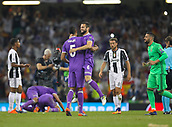 June 3rd 2017, National Stadium of Wales , Wales; UEFA Champions League Final, Juventus FC versus Real Madrid; Nacho of Real Madrid and Raphael Varane of Real Madrid celebrate at the final whistle as their team won the final by a score of 4-1