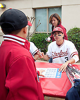STANFORD, CA - March 27, 2011: Kenny Diekroeger of Stanford baseball signs autographs for a fan after Stanford's game against Long Beach State at Sunken Diamond. Stanford won 6-5.