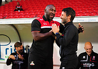 Doncaster Rovers manager Darren Moore, left, and Lincoln City manager Danny Cowley prior to the game<br /> <br /> Photographer Chris Vaughan/CameraSport<br /> <br /> EFL Leasing.com Trophy - Northern Section - Group H - Doncaster Rovers v Lincoln City - Tuesday 3rd September 2019 - Keepmoat Stadium - Doncaster<br />  <br /> World Copyright © 2018 CameraSport. All rights reserved. 43 Linden Ave. Countesthorpe. Leicester. England. LE8 5PG - Tel: +44 (0) 116 277 4147 - admin@camerasport.com - www.camerasport.com