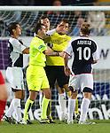 Darren Barr grabs his keeper Robert Olenkik by the face to pull him off Scott Arfield