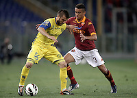 Calcio, Serie A: Roma vs Chievo Verona, Stadio Olimpico, Roma, 7 maggio  2013..ChievoVerona midfielder Perparim Hetemaj, of Finland, left, is challenged by AS Roma defender Marquinhos, of Brazil, during the Italian serie A football match between Roma and ChievoVerona at Rome's Olympic stadium, 7 maggio  2013..UPDATE IMAGES PRESS/Isabella Bonotto