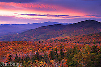 Black Cap is a small mountain near the village of North Conway, New Hampshire, which has a great view to the west and north.  I was on the peak to shoot the peak color in the Mount Washington Valley, when the drab sky caught the last bit of sunlight which came clear on the horizon.  Mount Washington, New England's highest peak is centered in the frame, with Mount Kearsarge to the right.