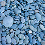 Beach abstract with blue pebbles on a beach in England