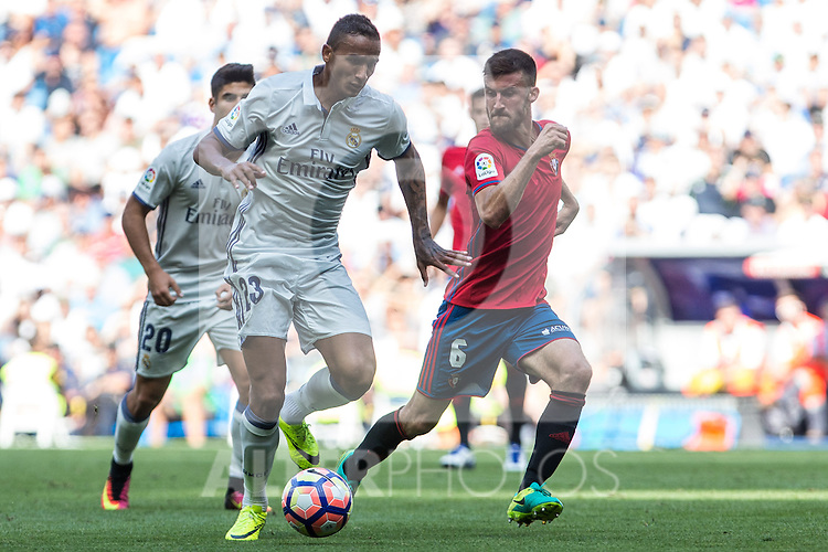 Real Madrid's Danilo Luiz da Silva and Club Atletico Osasuna's Oier Sanjurjo during the match of La Liga between Real Madrid and Club Atletico Osasuna at Santiago Bernabeu Estadium in Madrid. September 10, 2016. (ALTERPHOTOS/Rodrigo Jimenez)
