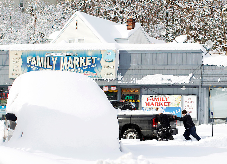 "Naugatuck, CT- 12, January 2010-011211CM08 Two men help get a truck out of the snow outside Family Market in Naugatuck Wednesday afternoon. Area towns reported up to 30"" of snow from  Winter Storm Benedict.  Christopher Massa Republican-American"