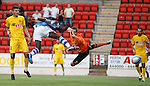 Gregory Tade heads in the opening goal for St Johnstone past keeper Ruud Boffin