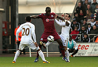 Pictured: Swansea's Leon Britton with an unorthodox tackle on Moussa Sissoko<br />