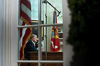 President Donald Trump is seen through the window of the Oval Office as he delivers a primetime address on the government shutdown and his funding request for over $5 billion for a southern border wall, at the White House in Washington, D.C.<br /> CAP/MPI/RS<br /> &copy;RS/MPI/Capital Pictures