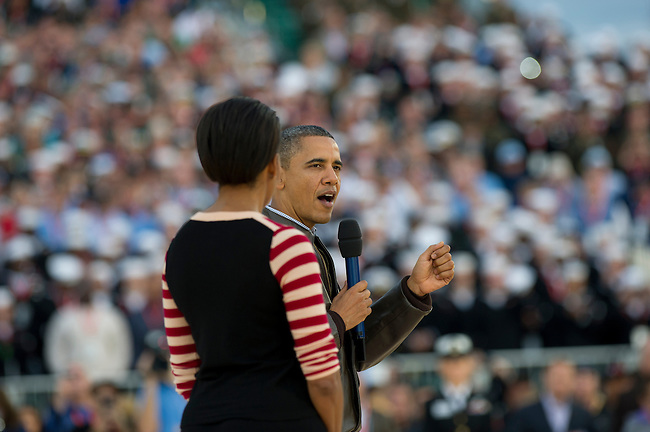SAN DIEGO, CA - NOVEMBER 11, 2011: (L to R) First Lady of the United States Michelle Obama and Barack Obama the 44th President of the United States in action during the Opening Ceremonies of the 2011 Quicken Loans Carrier Classic on the USS Carl Vinson prior to a game between the Michigan State Spartans and the North Carolina Tar Heels..(Photo by Scott Clarke / ESPN)..- RAW FILE AVAILABLE -.- CMI000165154.jpg -
