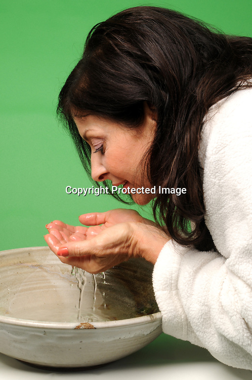 Stock photo of woman washing with water