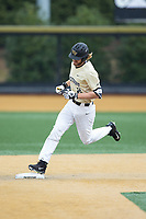Johnny Aiello (2) of the Wake Forest Demon Deacons touches second base after hitting a home run against the Georgia Tech Yellow Jackets at David F. Couch Ballpark on March 26, 2017 in  Winston-Salem, North Carolina.  The Demon Deacons defeated the Yellow Jackets 8-4.  (Brian Westerholt/Four Seam Images)