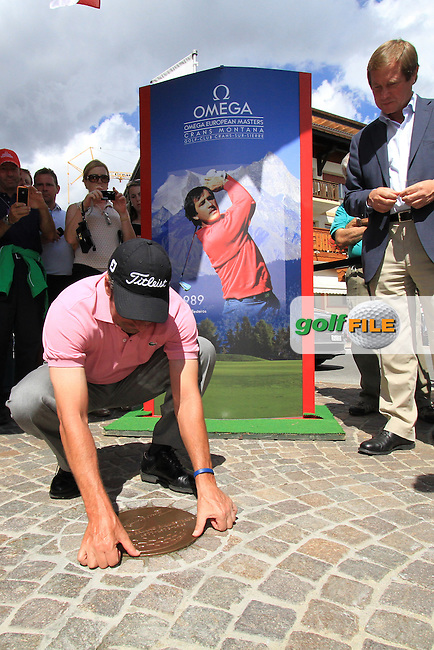 Jose Maria Olazabal (ESP) embedding a Plaque of Honour for former winners on the 1st day of the Omega European Masters, Crans-Sur-Sierre, Crans Montana, Switzerland..Picture: Golffile/Fran Caffrey..