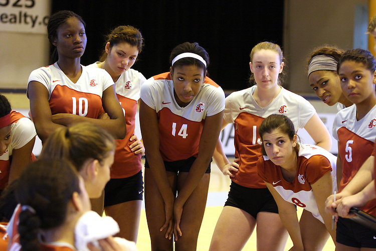 Washington State volleyball players Kimika Rozier (#10), Tangerine Wiggs (#14), Bree Flach (#13), Kelly Hyder (#8), and Faith Hutcherson (#5), along with the rest of the Cougs, listen intently to their coaches during the Cougars match against Notre Dame in the Idaho Classic Volleyball Tournament at Memorial Gym on September 6, 2008, in Moscow, Idaho.  The Fighting Irish prevailed in the match, sweeping the Cougs 3-0 (25-16, 25-22, 25-14).