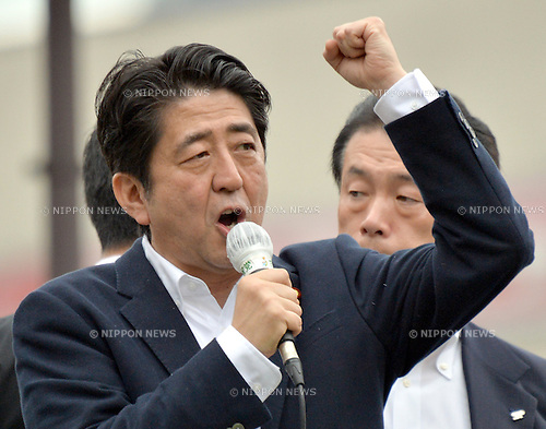 July 4, 2013, Tokyo, Japan - Japan's Prime Minister Shinzo Abe addresses a street rally from atop the vehicle on his stumping tour for a local candidate at Tokyo's Ikebukuro area on Thursday, July 4, 2013, as campaigning for the July 21 upper house election officially kicks off. <br /> <br /> Contested are half the 242seats in less powerful upper house of parliament that could make or break the Abe administration and Abenomics, his economic-revival plan.  (Photo by Natsuki Sakai/AFLO)