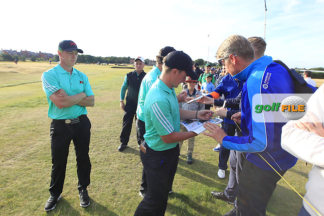 Grant Forrest (SCO), Paul Dunne (IRL), Cormac Sharvin (IRL) signing autographs during the afternoon singles for the Walker cup Royal Lytham St Annes, Lytham St Annes, Lancashire, England. 13/09/2015<br /> Picture Golffile | Fran Caffrey<br /> <br /> <br /> All photo usage must carry mandatory copyright credit (&copy; Golffile | Fran Caffrey)