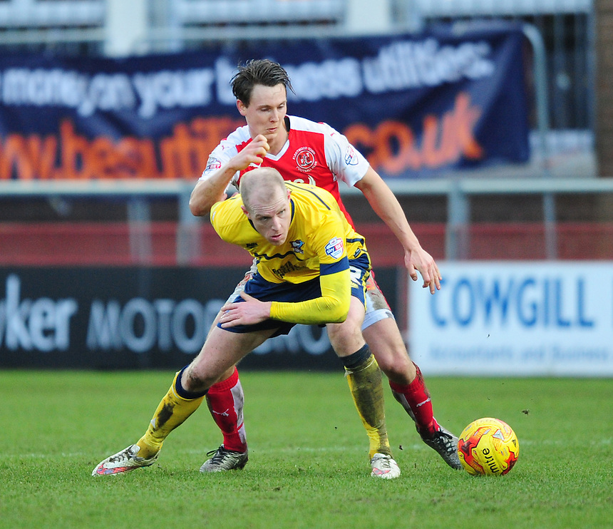 Scunthorpe United's Neil Bishop is tackled by Fleetwood Town's Eggert Jonsson<br /> <br /> Photographer Chris Vaughan/CameraSport<br /> <br /> Football - The Football League Sky Bet League One - Fleetwood Town v Scunthorpe United  - Saturday 20th February 2016 - Highbury Stadium - Fleetwood    <br /> <br /> &copy; CameraSport - 43 Linden Ave. Countesthorpe. Leicester. England. LE8 5PG - Tel: +44 (0) 116 277 4147 - admin@camerasport.com - www.camerasport.com